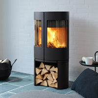 <h3>6600</h3> 6600 is a cast iron stove for Morsø. The center door design gives a more open stove than traditional designs with fewer and larger glass panes. The elliptical shape also increases the visible front surface without increasing the overall size of the stove.