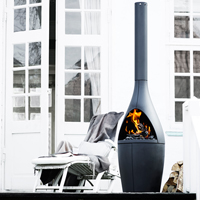 <h3>Kamino</h3> An outdoor fireplace for Morsø. Kamino places the fire away from the ground and up in a more visible position. The shape is a simple transition from the round fireplace to the chimney. The materials are cast iron and stainless steel.
